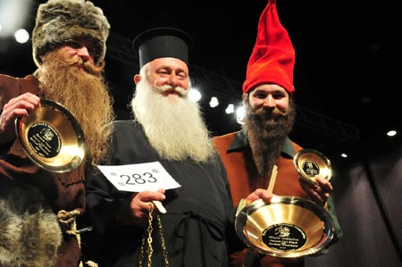 Beard champions with their trophies