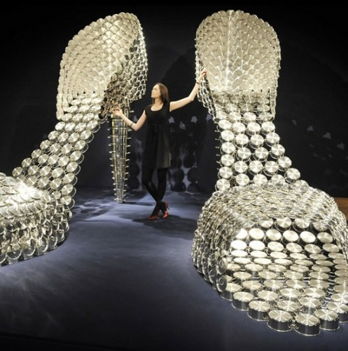 Giant shoes made from stainless steel cooking pots 1