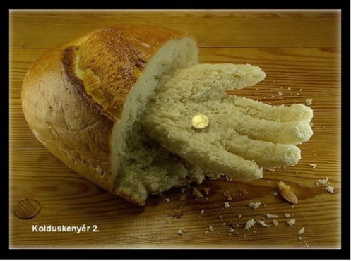 Loaf of bread has a hand out for something