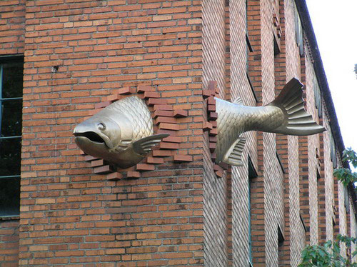 fish sculpture in building wall