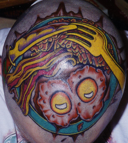 More pics of the tattooed style of the bald headed man Brain Head Tattoos