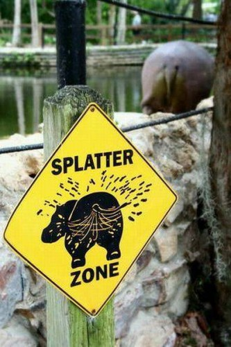 LOL pics - funny sign at the zoo - beware of flying hippo dung!