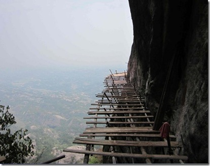 totally crazy extreme construction-building a walkway along the side of a mountain