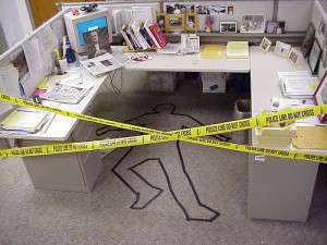 Body bag office prank - the cubicle becomes a crime scene.