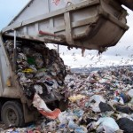 landfill getting filled by dump truck