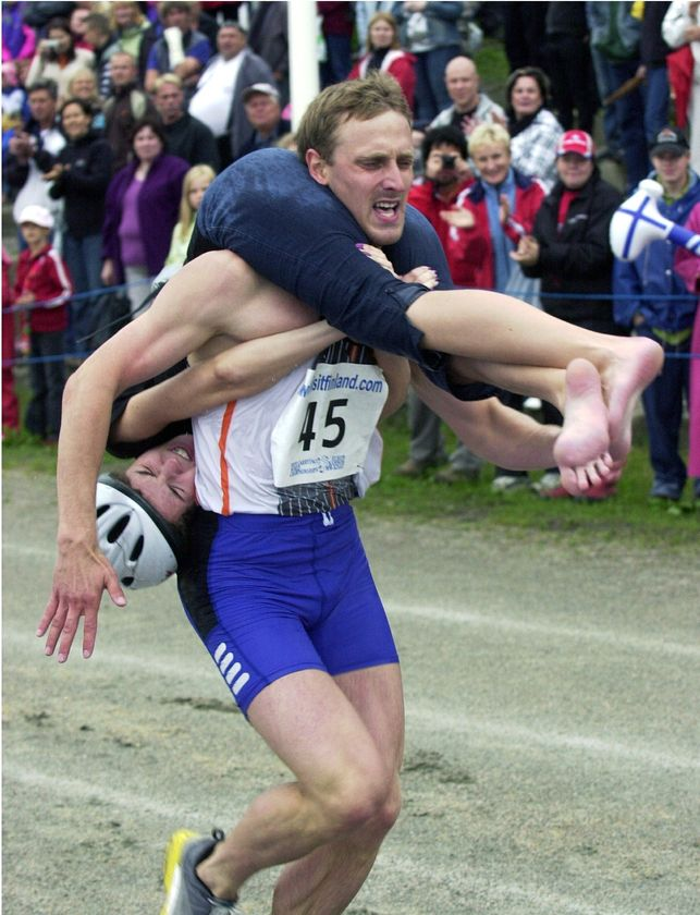 Wife carrying championships contestant