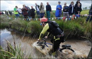 List of Bizarre Championships: bog mountain bike riding