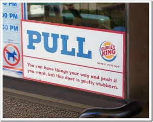 List o' Top 10 Harmless April Fool's Gags  - Switch the Push-Pull-Door-Signs
