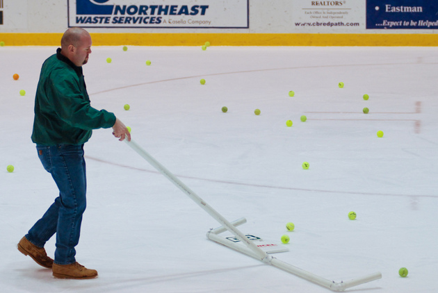 Tennis balls on the ice at a hockey game