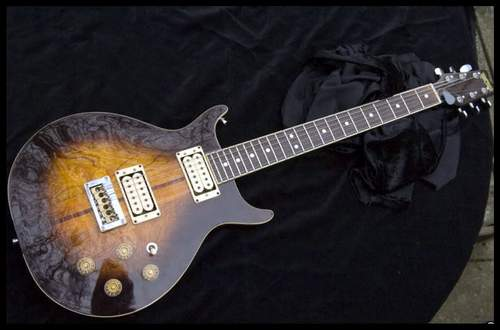 top ten list-List O' Top Ten Most Valuable Guitars-Bob-Marleys-Custom-Washburn-22-series-Hawk